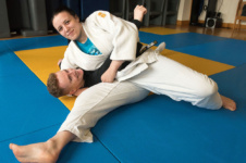 Male and female student showcase their skills at judo club