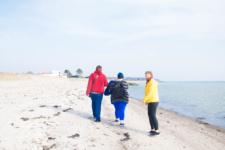 NWRC Student Union members walk along the beach