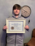 Ben Ferguson pictured with his scholarship.