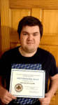 Darragh McLaughlin pictured with his scholarship.