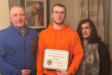 Rory Mullan who received one of the scholarships pictured with his parents Roisin and Damian Mullan.