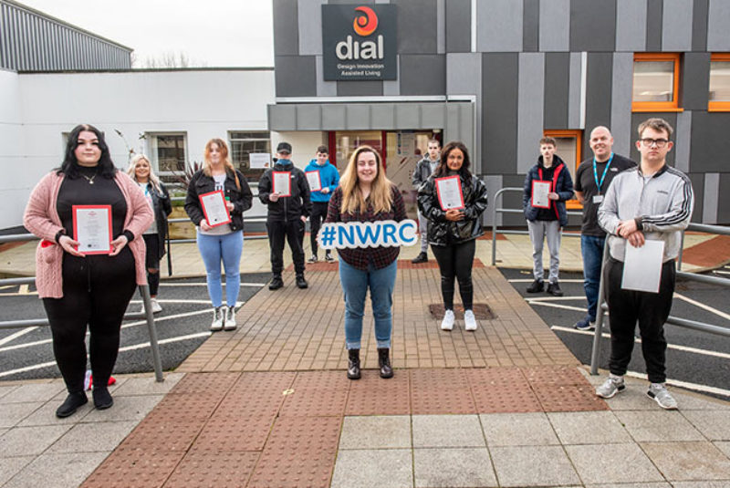 Group of NWRC students standing socially distanced outside DIAL building